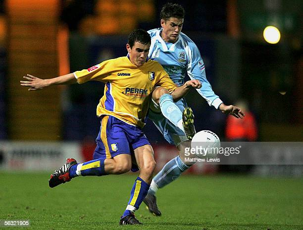 Jake Buxton of Mansfield and Michael Kightly of Grays compete for the ball during the FA Cup Second Round match between Mansfield Town and Grays...
