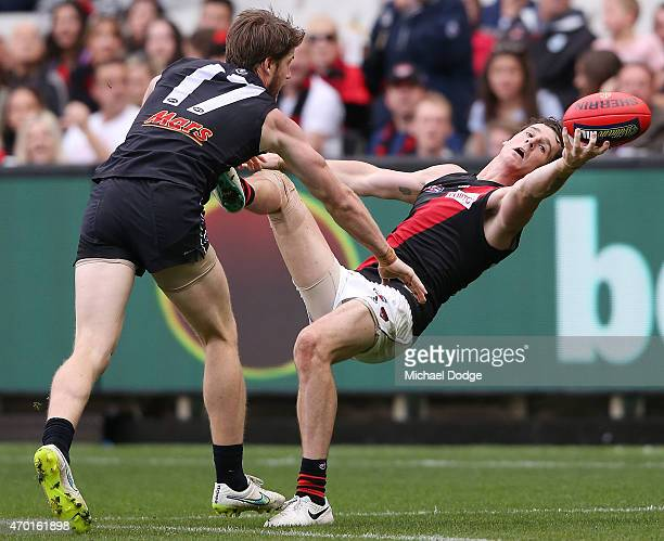 Jake Carlisle of the Bombers competes for the ball against Sam Rowe of the Blues during the round three AFL match between the Carlton Blues and the...