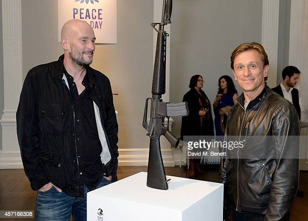 Jake Chapman and Jeremy Gilley attend the M16 Private View curated by Jake Chapman in support of Peace One Day at the Institute Of Contemporary Arts...