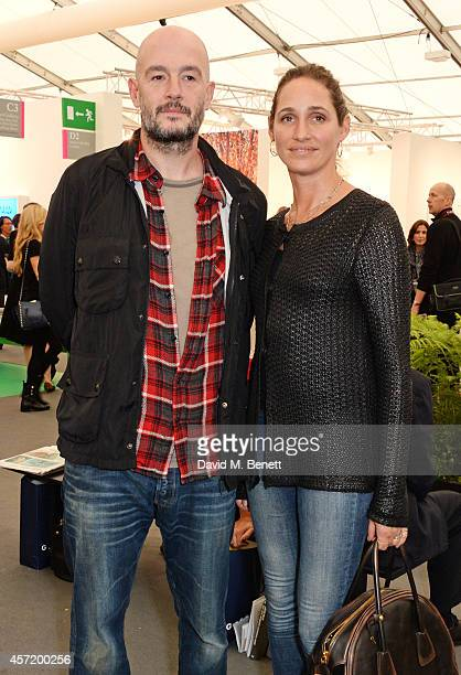 Jake Chapman and Rosemary Ferguson attend VIP Preview of the Frieze Art Fair 2014 in Regent's Park on October 14 2014 in London England