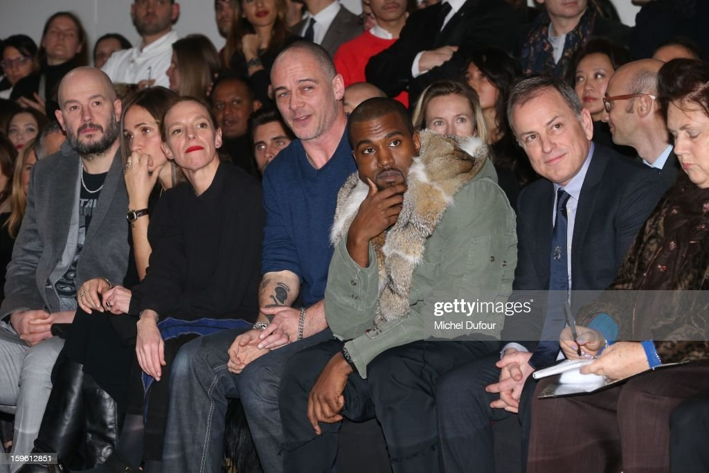 Jake Chapman, Rose Mary Ferguson, Tiphaine, Dino Chapman, Kanye West and Michael Burke attend the Louis Vuitton Men Autumn / Winter 2013 show as part of Paris Fashion Week on January 17, 2013 in Paris, France.