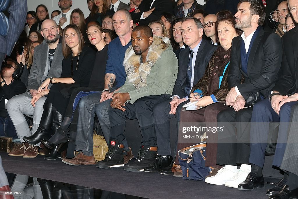 Jake Chapman, Rose Mary Ferguson, Tiphaine, Dino Chapman, Kanye West, Michael Burke, Suzy Menkes and Marc Jacobs sit in front row at the Louis Vuitton Men Autumn / Winter 2013 show as part of Paris Fashion Week on January 17, 2013 in Paris, France.