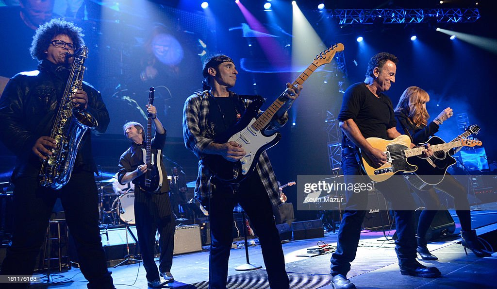 Jake Clemons, Gary W Tallent, Nils Lofgrin, Bruce Springsteen and Patti Scialfa perform onstage at MusiCares Person Of The Year Honoring Bruce Springsteen at Los Angeles Convention Center on February 8, 2013 in Los Angeles, California.