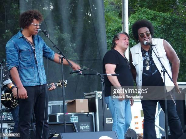 Jake Clemons Joe D'Urso and Jeffrey Gaines perform at the RocklandBergen Music Festival at German Masonic Park on June 24 2017 in Tappan New York