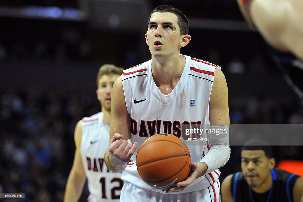 Jake Cohen #15 of the Davidson Wildcats concentrates at the free throw line against the Duke Blue Devils at Time Warner Cable Arena on January 2, 2013 in Charlotte, North Carolina.