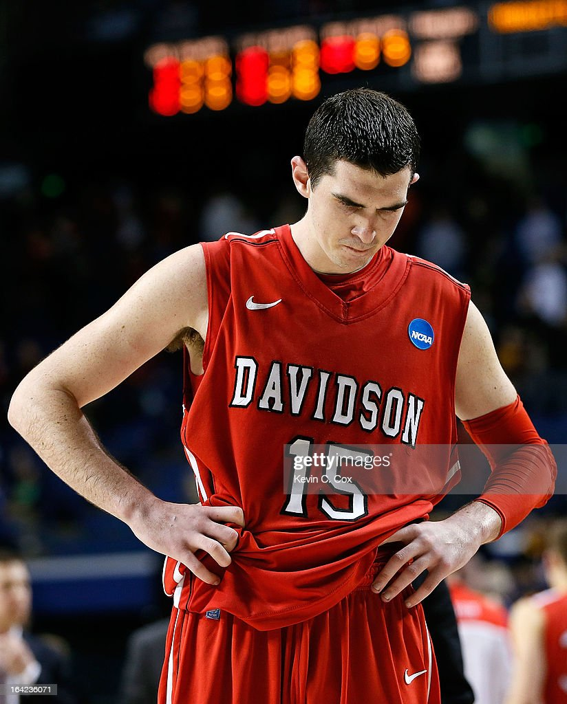 Jake Cohen #15 of the Davidson Wildcats reacts after losing 59-58 to the Marquette Golden Eagles during the second round of the 2013 NCAA Men's Basketball Tournament at the Rupp Arena on March 21, 2013 in Lexington, Kentucky.