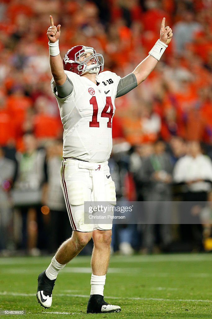 Jake Coker #14 of the Alabama Crimson Tide celebrates after Derrick Henry #2 scored a one yard touchdown in the fourth quarter against the Clemson Tigers during the 2016 College Football Playoff National Championship Game at University of Phoenix Stadium on January 11, 2016 in Glendale, Arizona.