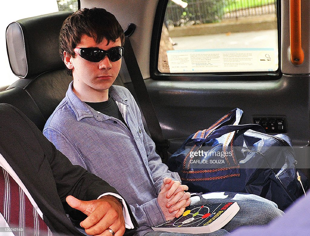 Jake Davis, 18, leaves in a taxi from Westminster Magistrates Court in London, on August 1, 2011. An 18-year-old British man arrested on suspicion of being a spokesman for hacking groups LulzSec and Anonymous was granted bail when he appeared in a London court on Monday. Jake Davis is charged with hacking into websites, including that of Britain's Serious Organised Crime Agency (SOCA), which was out of service for several hours on June 20 after apparently being targeted. AFP PHOTO / CARL DE SOUZA