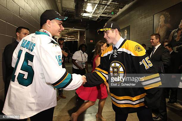 Jake DeBrusk 14th overall selection by the the Boston Bruins and Timo Meier ninth overall selection by the San Jose Sharks shake hands during Round...
