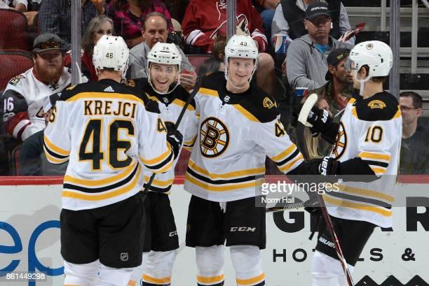 Jake DeBrusk Danton Heinen Anders Bjork and David Krejci of the Boston Bruins celebrate a second period goal against the Arizona Coyotes at Gila...