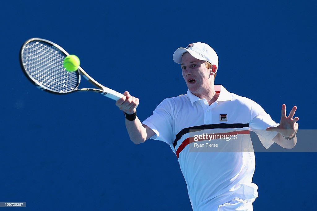Jake Delaney of Australia plays a forehand in his first round match against Hyeon Chung of Korea during the 2013 Australian Open Junior Championships at Melbourne Park on January 19, 2013 in Melbourne, Australia.