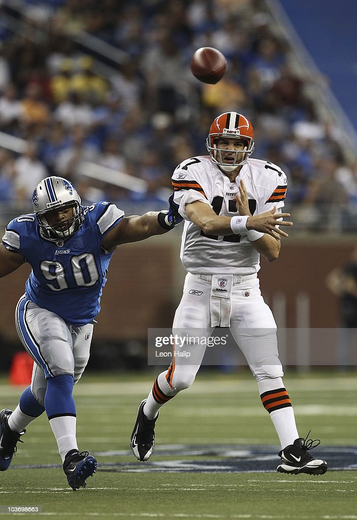 Jake Delhomme #17 of the Cleveland Browns rolls out and throws a pass as Ndamukong Suh #90 of the Detroit Lions pursues during the second quarter of the preseason game at Ford Field on August 28, 2010 in Detroit, Michigan. The Lions defeated the Browns 35-27.