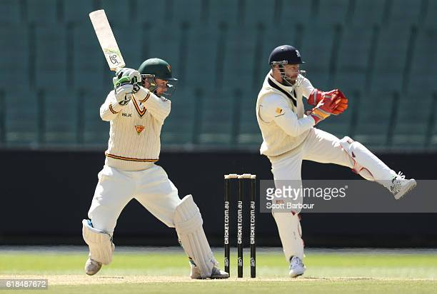 Jake Doran of Tasmania bats as wicketkeeper Matthew Wade of Victoria looks on during day three of the Sheffield Shield match between Victoria and...