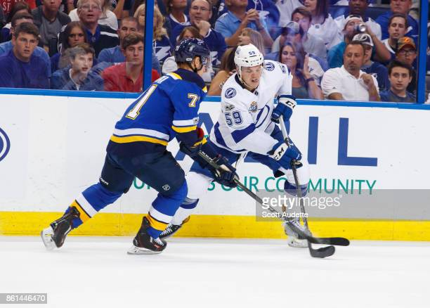 Jake Dotchin of the Tampa Bay Lightning skates against Vladimir Sobotka of the St Louis Blues during the third period at Amalie Arena on October 14...