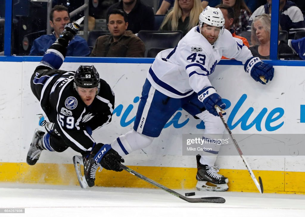 Jake Dotchin #59 of the Tampa Bay Lightning tries to check Nazem Kadri #43 of the Toronto Maple Leafs during the third period at the Amalie Arena on March 16, 2017 in Tampa, Florida.