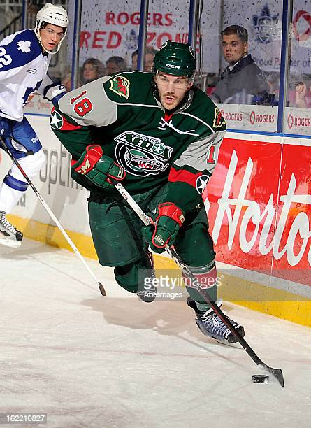 Jake Dowell of the Houston Aeros controls the puck against the Toronto Marlies during AHL game action February 18 2013 at Ricoh Coliseum in Toronto...