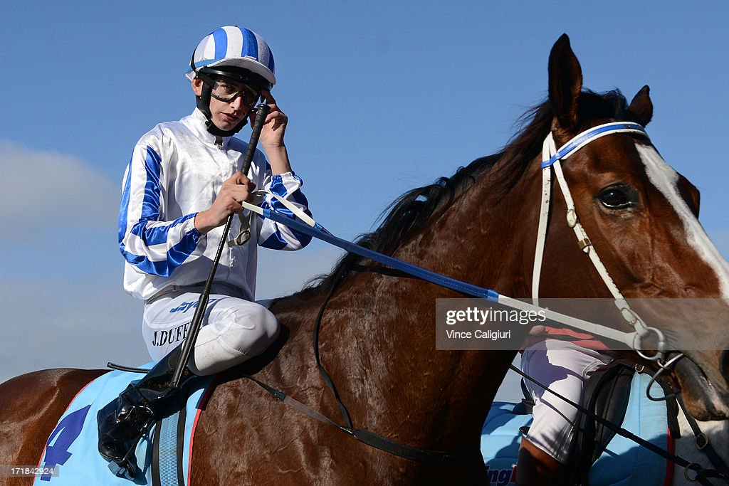 Jake Duffy riding Dayita after winning the Dominant Travis Harrison Cup during Melbourne Racing at Moonee Valley Racecourse on June 29, 2013 in Melbourne, Australia.