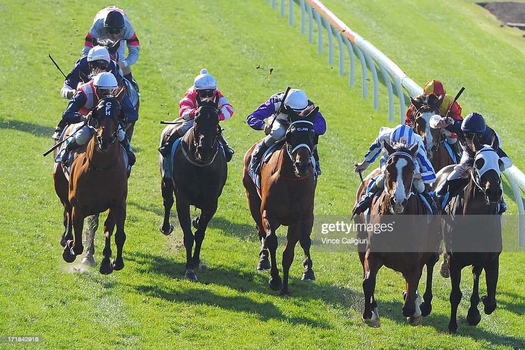 Jake Duffy riding Dayita defeats Patrick Moloney riding Imoto (R) in the Dominant Travis Harrison Cup during Melbourne Racing at Moonee Valley Racecourse on June 29, 2013 in Melbourne, Australia.