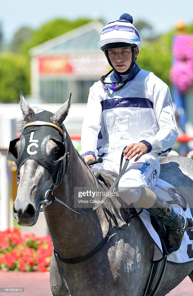 Jake Duffy riding Zlatan after winning the BMW Melbourne Handicap during Melbourne Racing at Caulfield Racecourse on February 9, 2013 in Melbourne, Australia.