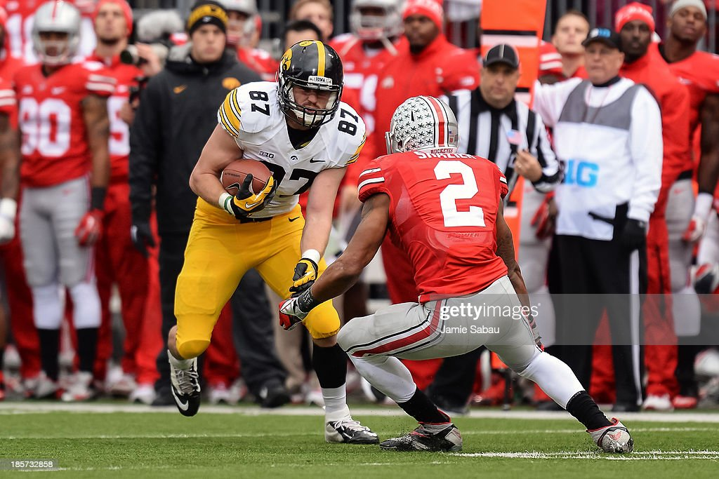 Jake Duzey #87 of the Iowa Hawkeyes runs with the ball against the Ohio State Buckeyes at Ohio Stadium on October 19, 2013 in Columbus, Ohio.