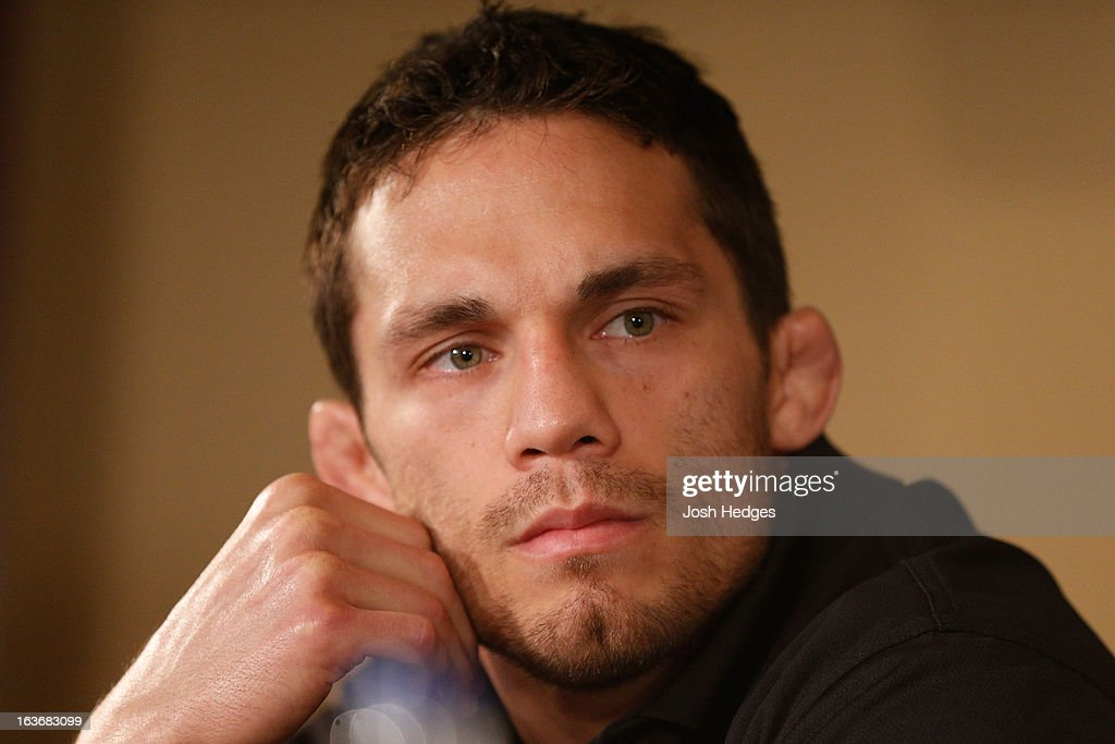 <a gi-track='captionPersonalityLinkClicked' href=/galleries/search?phrase=Jake+Ellenberger&family=editorial&specificpeople=4509591 ng-click='$event.stopPropagation()'>Jake Ellenberger</a> interacts with media during the final press conference ahead of his UFC 158 bout at Bell Centre on March 14, 2013 in Montreal, Quebec, Canada.