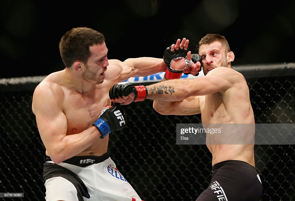 Jake Ellenberger of the United States and Tarec Saffiedine of Belgium exchange punches in their welterweight bout during the UFC Fight Night event at the Prudential Center on January 30, 2016 in Newark, New Jersey. Saffiedine won by unanimous decision.