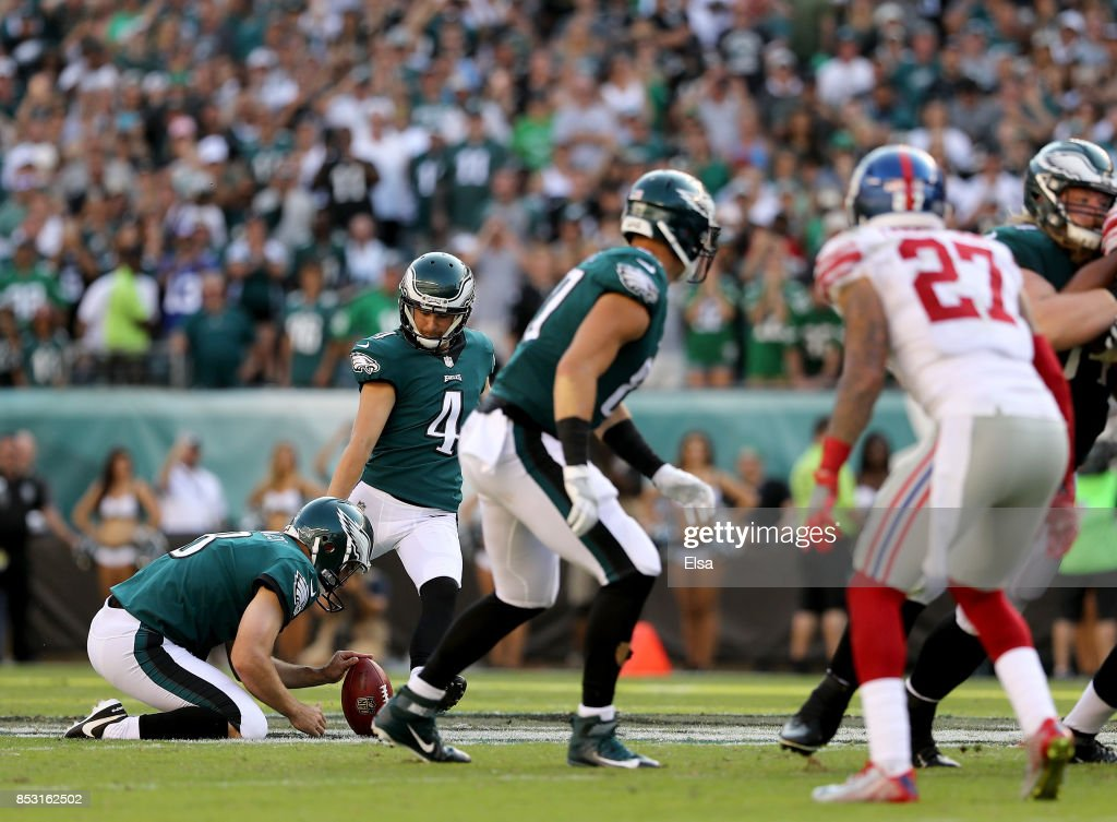 Jake Elliott #4 of the Philadelphia Eagles kicks a 61-yeard field goal to win the game as Donnie Jones #8 holds on September 24, 2017 at Lincoln Financial Field in Philadelphia, Pennsylvania.The Philadelphia Eagles defeated the New York Giants 27-24.