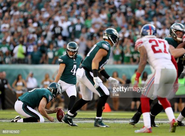 Jake Elliott of the Philadelphia Eagles kicks a 61yeard field goal to win the game as Donnie Jones holds on September 24 2017 at Lincoln Financial...
