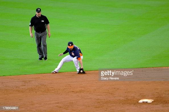 Jake Elmore of the Houston Astros fields a ground ball in the fifth inning during a game against the Toronto Blue Jays at Minute Maid Park on August...