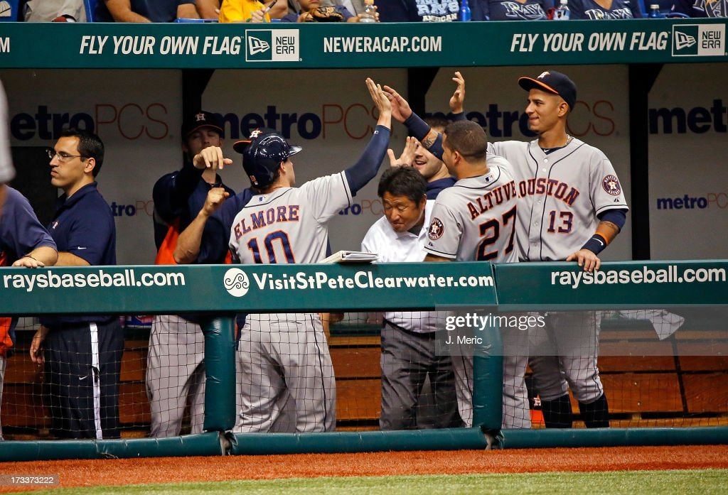 Jake Elmore #10 of the Houston Astros is congratulated after scoring a run in the first inning against the Tampa Bay Rays during the game at Tropicana Field on July 12, 2013 in St. Petersburg, Florida.