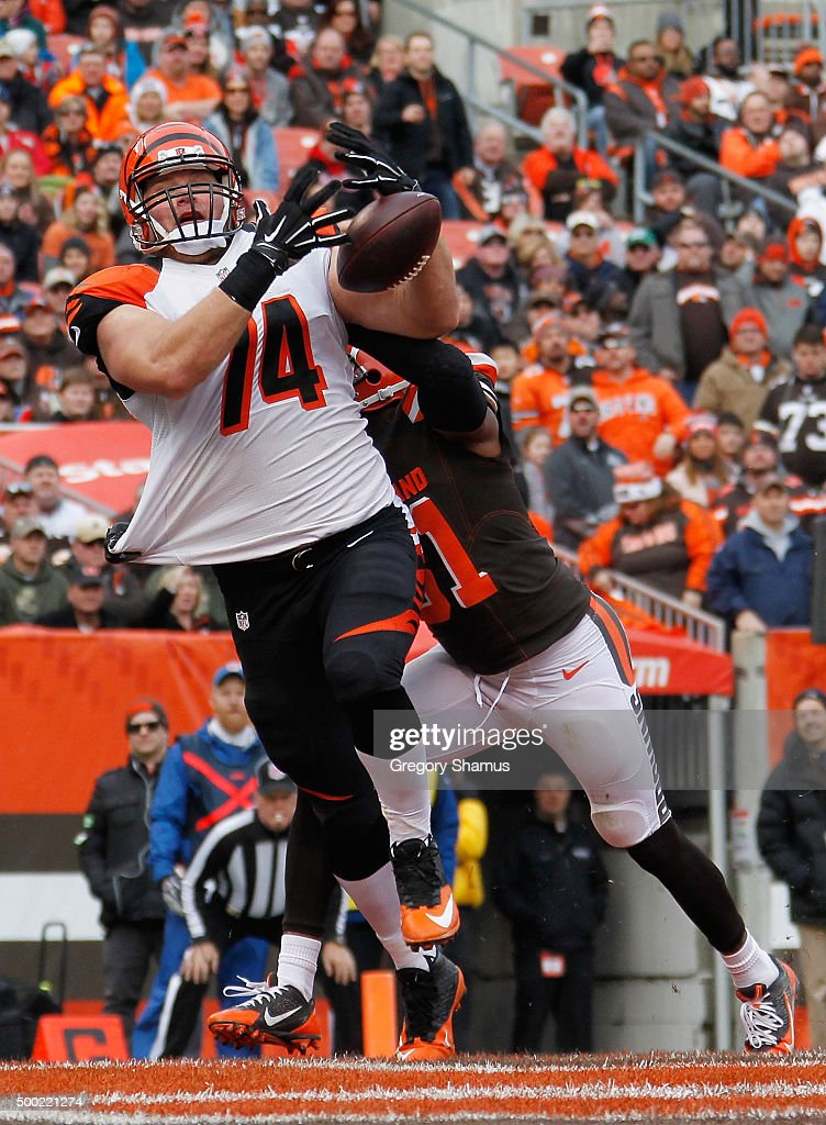 Jake Fisher of the Cincinnati Bengals tries to come down with a first quarter touchdown pass in front of Barkevious Mingo of the Cleveland Browns at...