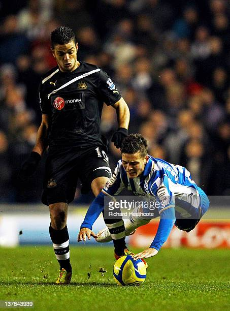 Jake ForsterCaskey of Brighton is brought down by Hatem Ben Arfa of Newcastle during the FA Cup fourth round match between Brighton and Hove Albion...