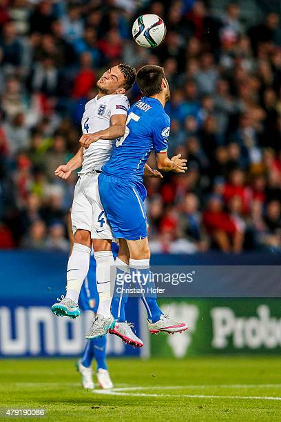 Jake ForsterCaskey of England competes for the ball in the air with Daniele Rugani of Italy during the UEFA Under21 European Championship 2015 match...