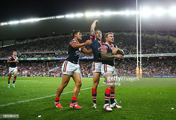 Jake Friend of the Roosters celebrates with Mitchell Pearce and Roger TuivasaSheck after scoring a try during the NRL Preliminary Final match between...