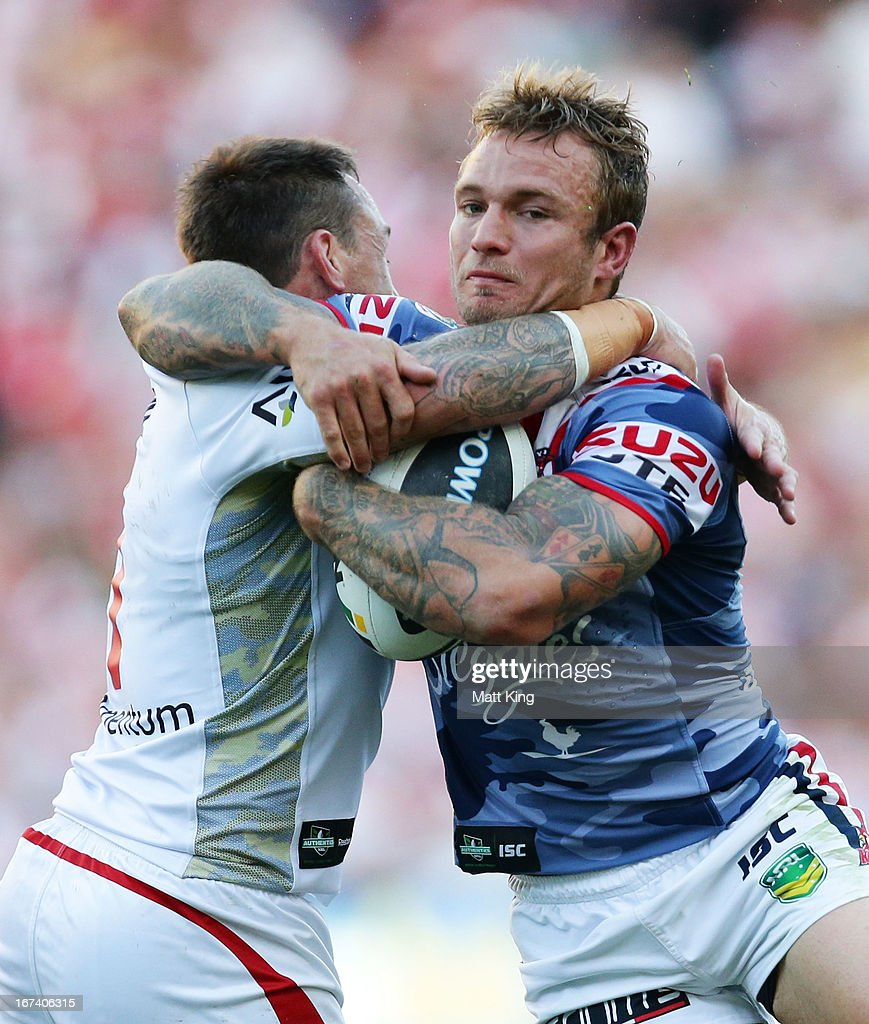 Jake Friend of the Roosters is tackled during the round seven NRL match between the Sydney Roosters and the St George Illawarra Dragons at Allianz Stadium on April 25, 2013 in Sydney, Australia.