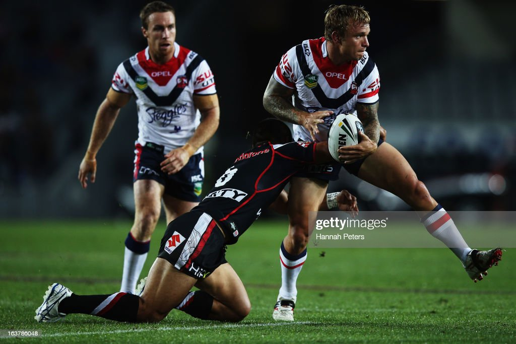 Jake Friend of the Roosters looks to pass the ball out during the round two NRL match between the New Zealand Warriors and the Sydney Roosters at Eden Park on March 16, 2013 in Auckland, New Zealand.