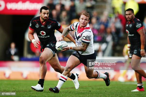 Jake Friend of the Roosters runs the ball against Ben Matulino of the Warriors during the round nine NRL match between the New Zealand Warriors and...