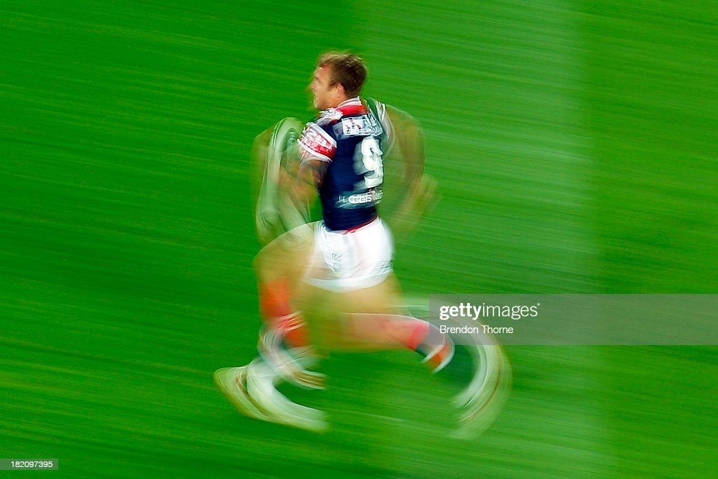 Jake Friend of the Roosters runs with the ball during the NRL Preliminary Final match between the Sydney Roosters and the Newcastle Knights at Allianz Stadium on September 28, 2013 in Sydney, Australia.