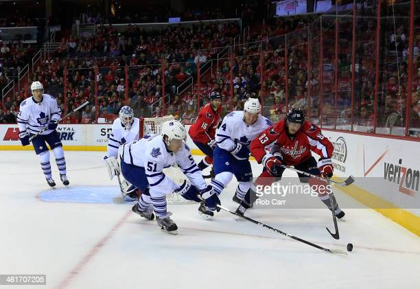Jake Gardiner and Morgan Rielly of the Toronto Maple Leafs go after the puck with Jay Beagle of the Washington Capitals during the first period at...