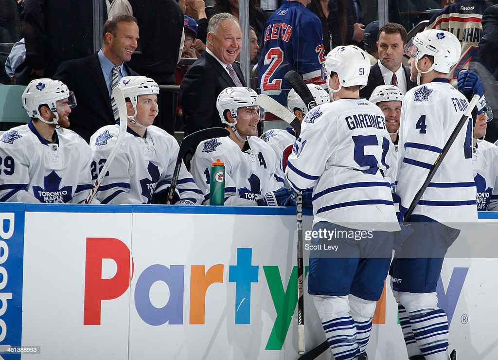 <a gi-track='captionPersonalityLinkClicked' href=/galleries/search?phrase=Jake+Gardiner&family=editorial&specificpeople=4884939 ng-click='$event.stopPropagation()'>Jake Gardiner</a> #51, <a gi-track='captionPersonalityLinkClicked' href=/galleries/search?phrase=Cody+Franson&family=editorial&specificpeople=2125769 ng-click='$event.stopPropagation()'>Cody Franson</a> #4 and Head Coach <a gi-track='captionPersonalityLinkClicked' href=/galleries/search?phrase=Randy+Carlyle+-+Ice+Hockey+Coach&family=editorial&specificpeople=679108 ng-click='$event.stopPropagation()'>Randy Carlyle</a> of the Toronto Maple Leafs share a laugh during a break in the action against the New York Rangers at Madison Square Garden on December 23, 2013 in New York City. The New York Rangers won 2-1.