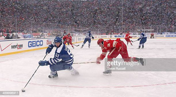 ANN ARBOR MI JANUARY 1 Jake Gardiner eludes Joakim Andersson as the Toronto Maple Leafs beat the Detroit Red Wings 32 in a shootout at the Big House...