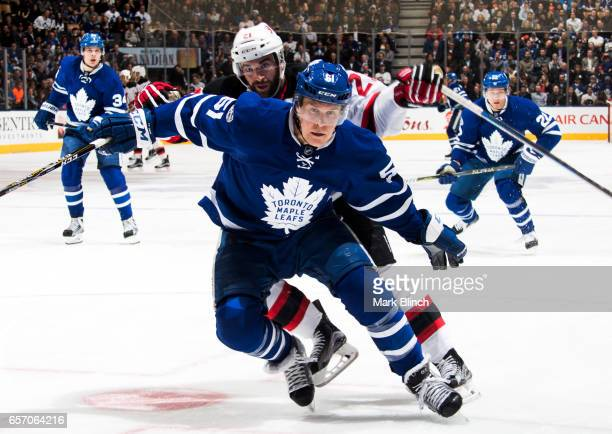 Jake Gardiner of the Toronto Maple Leafs and Kyle Palmieri of the New Jersey Devils head to the corner during the second period at the Air Canada...