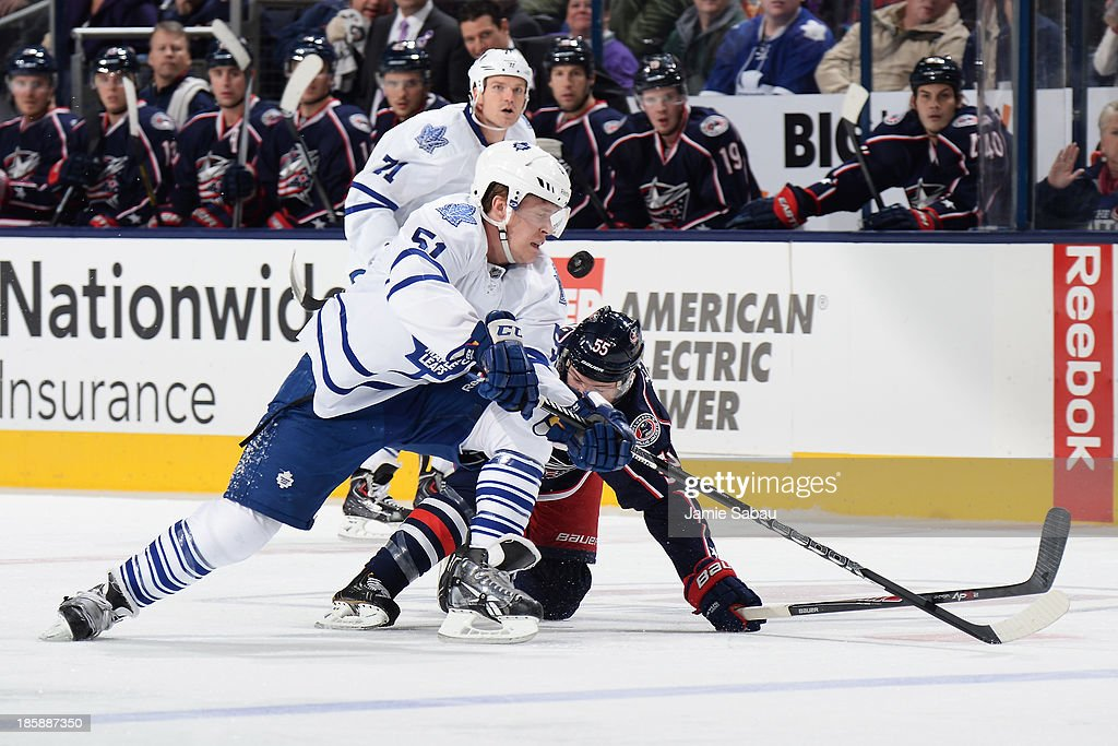 <a gi-track='captionPersonalityLinkClicked' href=/galleries/search?phrase=Jake+Gardiner&family=editorial&specificpeople=4884939 ng-click='$event.stopPropagation()'>Jake Gardiner</a> #51 of the Toronto Maple Leafs and <a gi-track='captionPersonalityLinkClicked' href=/galleries/search?phrase=Mark+Letestu&family=editorial&specificpeople=4601071 ng-click='$event.stopPropagation()'>Mark Letestu</a> #55 of the Columbus Blue Jackets battle for possession of the puck during the third period on October 25, 2013 at Nationwide Arena in Columbus, Ohio. Columbus defeated Toronto 5-2.