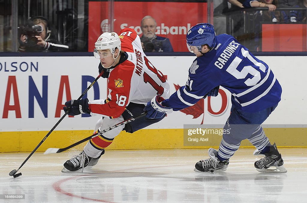 Jake Gardiner #51 of the Toronto Maple Leafs battles for the puck with Shawn Matthias #18 of the Florida Panthers during NHL game action March 26, 2013 at the Air Canada Centre in Toronto, Ontario, Canada.