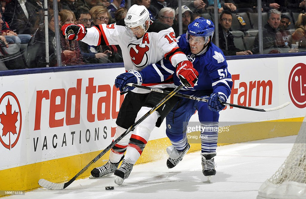Jake Gardiner #51 of the Toronto Maple Leafs battles for the puck with <a gi-track='captionPersonalityLinkClicked' href=/galleries/search?phrase=Travis+Zajac&family=editorial&specificpeople=864182 ng-click='$event.stopPropagation()'>Travis Zajac</a> #19 of the New Jersey Devils during NHL game action April 15, 2013 at the Air Canada Centre in Toronto, Ontario, Canada.