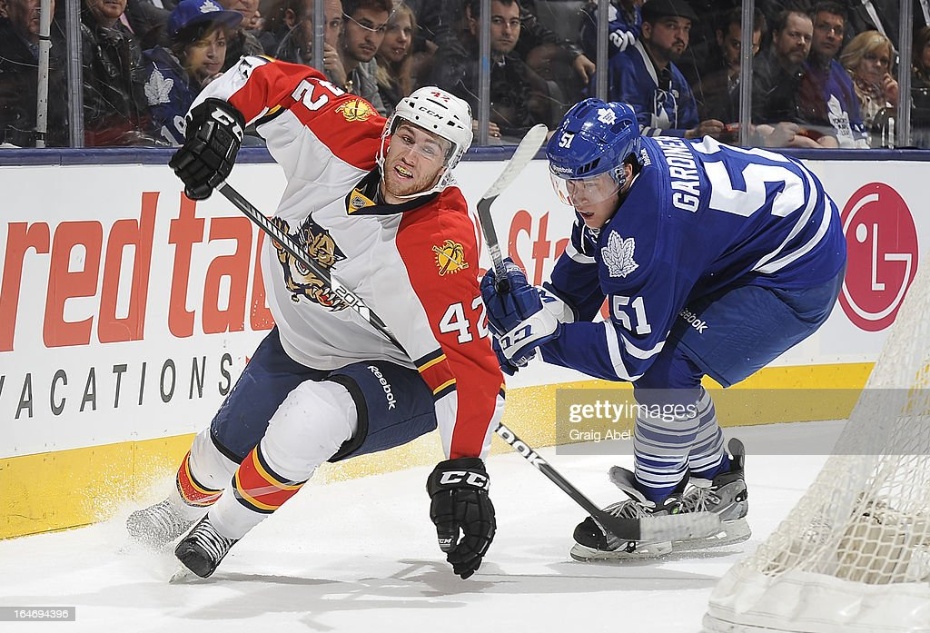 Jake Gardiner #51 of the Toronto Maple Leafs battles with Quinton Howden #42 of the Florida Panthers during NHL game action March 26, 2013 at the Air Canada Centre in Toronto, Ontario, Canada.