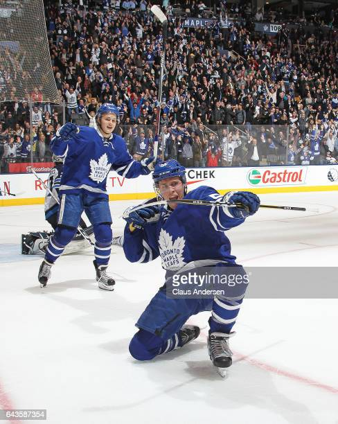 Jake Gardiner of the Toronto Maple Leafs celebrates his overtime winning goal against the Winnipeg Jets during an NHL game at Air Canada Centre on...