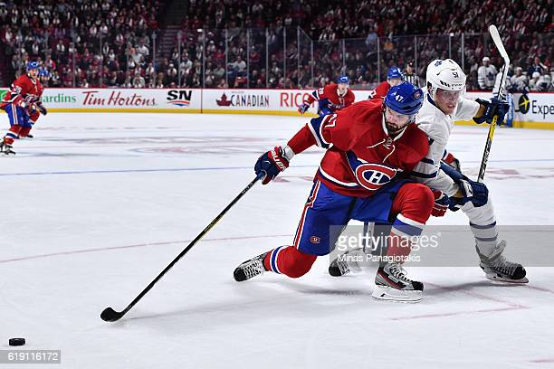 Jake Gardiner of the Toronto Maple Leafs defends against Alexander Radulov of the Montreal Canadiens during the NHL game at the Bell Centre on...