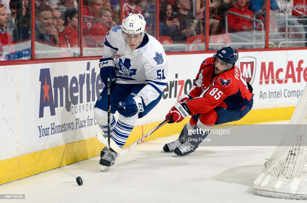 Jake Gardiner #51 of the Toronto Maple Leafs handles the puck in the second period against <a gi-track='captionPersonalityLinkClicked' href=/galleries/search?phrase=Mathieu+Perreault&family=editorial&specificpeople=776813 ng-click='$event.stopPropagation()'>Mathieu Perreault</a> #85 of the Washington Capitals at the Verizon Center on April 16, 2013 in Washington, DC.