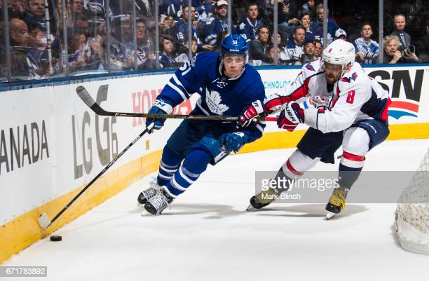 Jake Gardiner of the Toronto Maple Leafs skates against Alex Ovechkin of the Washington Capitals during the second period in Game Four of the Eastern...